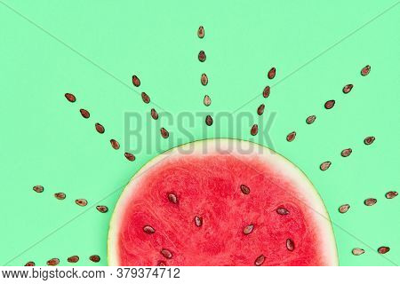 Ripe Watermelon With Seeds In The Form Of The Sun. Creative Concept. Food Art