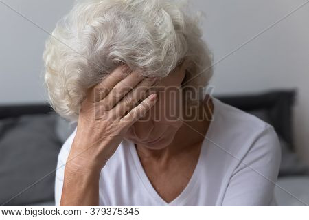 Aged Woman Wakeup Touches Forehead Feeling Unwell Suffer From Headache