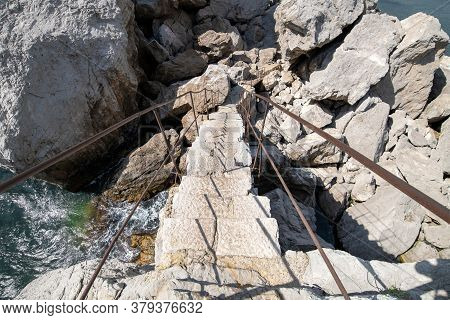 Stone Steps Leading From The Mountain To The Sea In Crimea