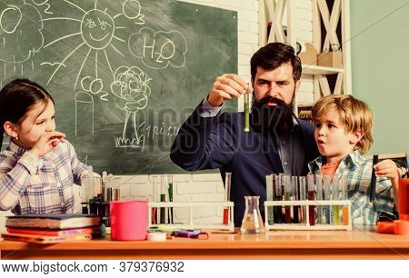 Fascinating Chemical Reaction. Teacher And Pupils Test Tubes In Classroom. Interesting School Classe