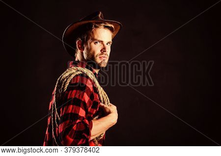Man Unshaven Cowboy Black Background. Lasso Is Used In Rodeos As Part Of Competitive Events. Lasso C