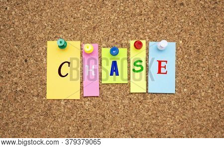 Multicolor Notes With Letters Pinned On A Cork Notice Board.