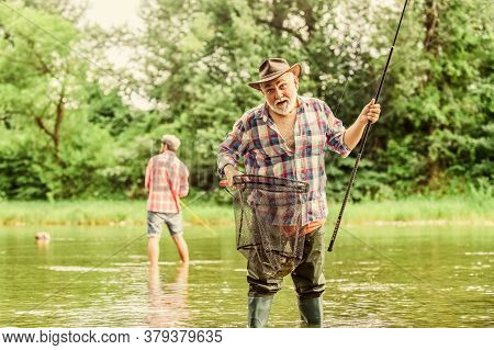 Fishing Time. Family Bonding. Summer Weekend. Two Fishermen With Fishing Rods, Selective Focus. Reti