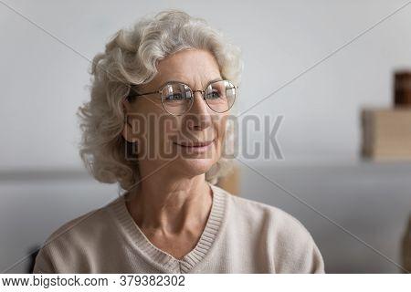 Headshot Portrait Elderly Woman In Glasses Look Into Distance