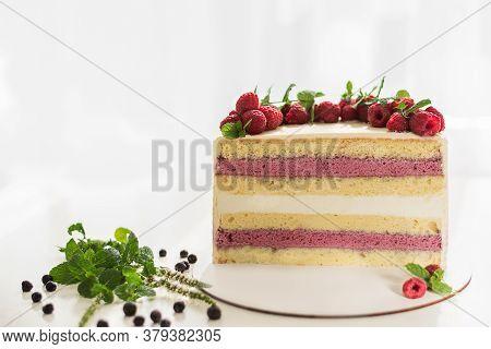 Half Or Slice Of Delicious Fresh Cake On A White Background. Raspberry Cake. Raspberry Cake With Blu