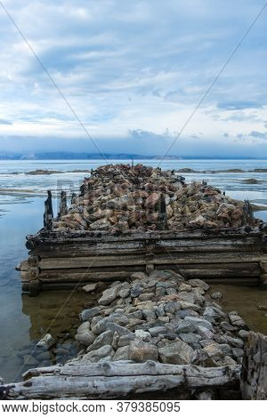 The Remains Of The Old Pier On Baikal