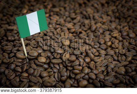 Nigeria Flag Sticking In Roasted Coffee Beans. The Concept Of Export And Import Of Coffee
