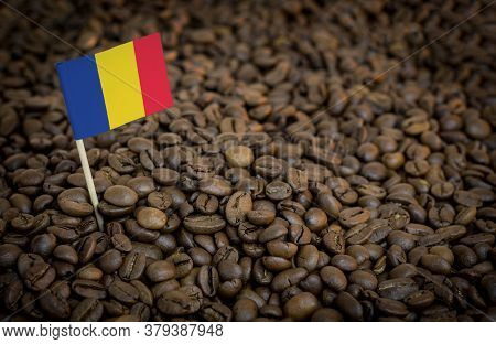 Romania Flag Sticking In Roasted Coffee Beans. The Concept Of Export And Import Of Coffee