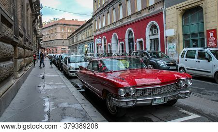 Budapest, Hungary - June 28th 2013: Vintage Red Cadillac Deville Car Parked In A Budapest Street In