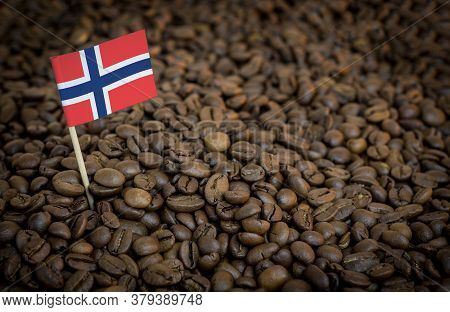 Norway Flag Sticking In Roasted Coffee Beans. The Concept Of Export And Import Of Coffee
