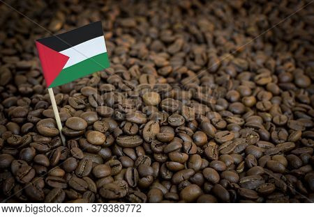 Palestine Flag Sticking In Roasted Coffee Beans. The Concept Of Export And Import Of Coffee