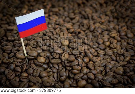 Russia Flag Sticking In Roasted Coffee Beans. The Concept Of Export And Import Of Coffee