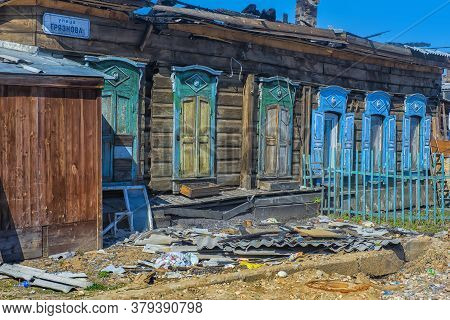 Abandoned Wooden House On The Street In The Center Of Irkutsk