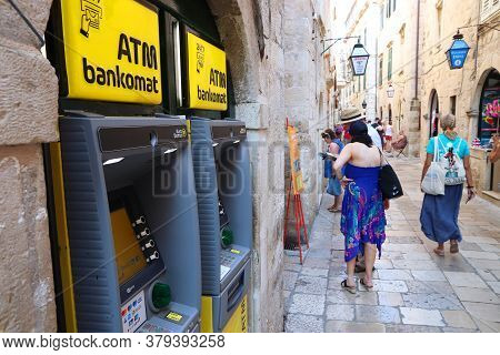 Dubrovnik, Croatia - July 26, 2019: Tourists Walk By Atms At A Shopping Street In Dubrovnik Old Town