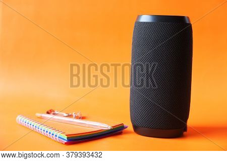Smart Speaker And Keyboard With Copy Space On Orange Background Background