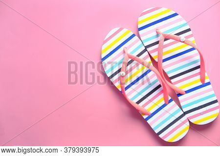 Top View Of Colorful Sandals On Pink Background