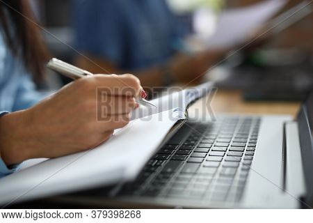 Female Hand Holds Pen With Notebook. Copywriting Courses For Beginners Concept