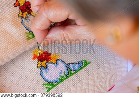 Woman Creating Black Details To A Colorful Cross Stitch Design. Concepts Of Manual Work Or Work At H