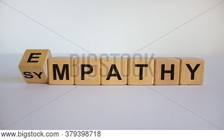 Turned Cube And Changed The Word 'sympathy' To 'empathy'. Beautiful White Background. Copy Space.