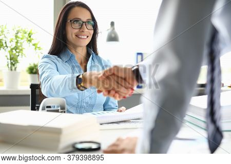 Businesswoman Smiles And Shakes Hands With Her Partner. Effective And Successful Cooperation In Busi