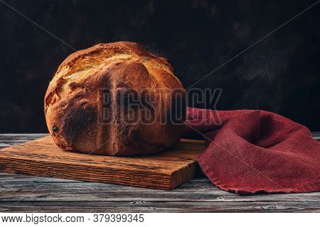 Fresh Homemade Loaf Of Bread With Crispy Toasted Crust. Selective Focus, Copy Space.