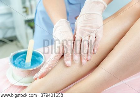 Sugar And Waxing Depilation Of The Feet In The Beauty Salon. Rid Of Hair On The Legs. Sugaring. Mast