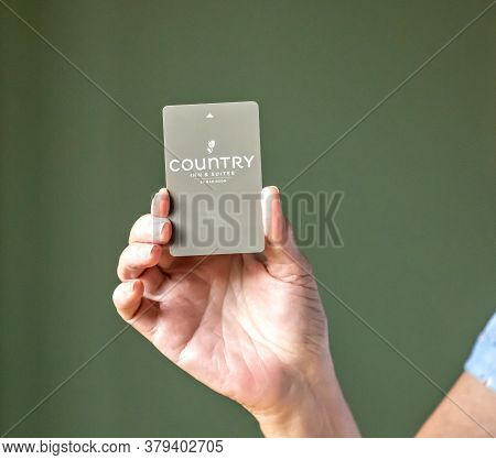 Bemidji, Mn - 20 Jul 2020: Womans Hand Holding Room Security Keycard For Country Inn And Suites Hote