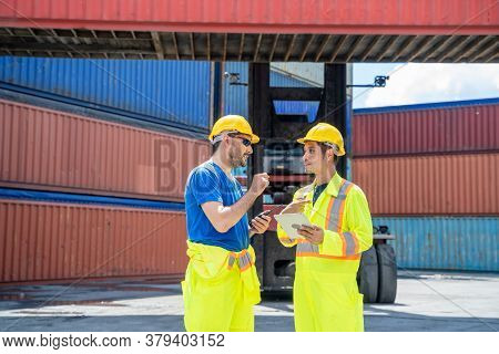 Engineer And Supervisor Checking And Control Loading Containers Box From Cargo At Container Cargo,bu