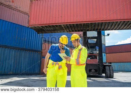 Foreman And Staff Checking At Container Cargo Harbor Holding Tablet To Loading Containers For Logist