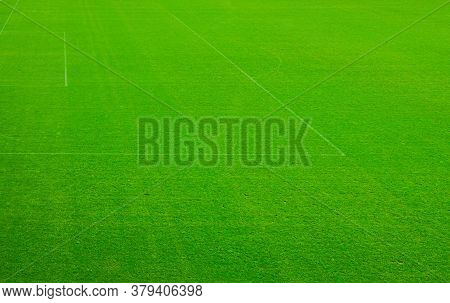 Top Aerial View Of Football Pitch Soccer Field With Green Grass Lawn, Pattern Texture, White Marking