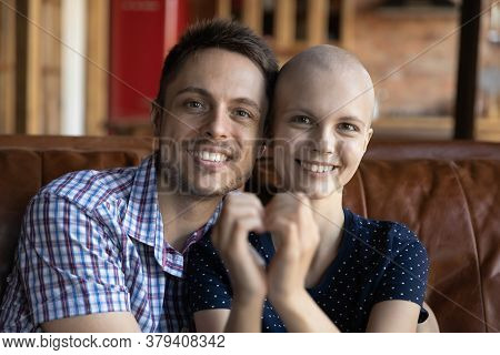 Portrait Of Happy Husband And Sick Wife Show Heart Gesture