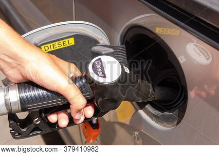 Refuelling Cars At The Service Station With Pumping Gasoline Into The Car, Diesel Or Gasoline Ecosys