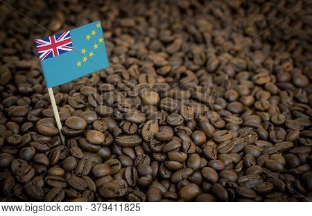 Tuvalu Flag Sticking In Roasted Coffee Beans. The Concept Of Export And Import Of Coffee