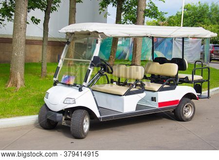 Multi-seat Golf Cart. Electric Car For Excursions In The Park. Transportation Of People.