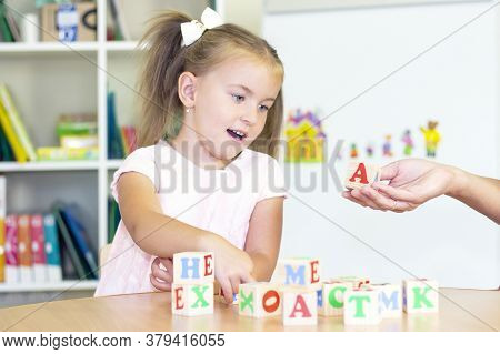 Developmental And Speech Therapy Classes With A Child-girl. Speech Therapy Exercises And Games With