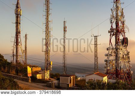 Telecommunications Masts - Directional Mobile Phone Antenna Dishes.