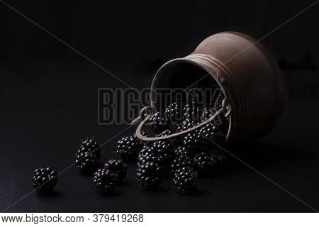 Ripe Blackberries In A Bucket. Dark Background, Rustic