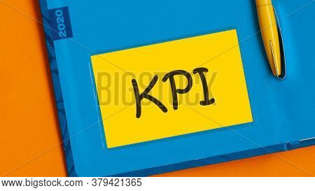 The Word Kpi Is Written In Black Marker On The Yellow Paper For Notes. Kpi - Key Performance Indicat