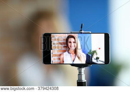 Close-up Of Woman Recording Video On Smartphone. Video-blogger Speaking On Camera Of Cellphone. Lady