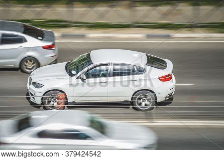Moscow , Russia - April 30, 2020: White Bmw X6 On The City Road. Fast Moving Car On Moscow Streets.