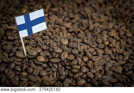 Finland Flag Sticking In Roasted Coffee Beans. The Concept Of Export And Import Of Coffee