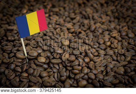 Chad Flag Sticking In Roasted Coffee Beans. The Concept Of Export And Import Of Coffee