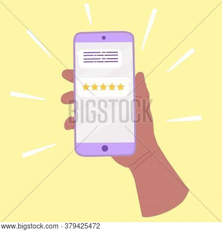 Hand Holds A Smartphone. On Screen Feedback And Five Star Rating. The Client Appreciates The Work An