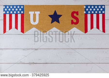 Celebrating Us. Federal Holiday With Us Word Of Letters In The America Flag On Old Wood Background