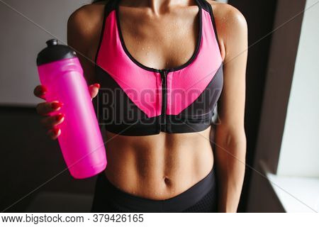 Nutritional Supplement, Weight Loss And Diet. Fit Muscular Woman Holding Shaker With Protein. Sports