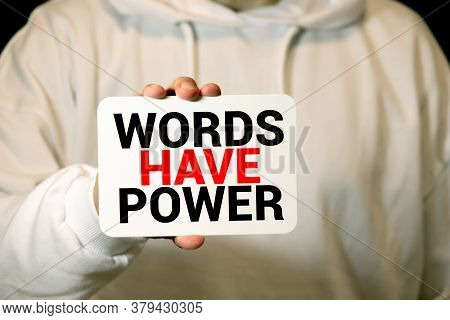 The Phrase Words Have Power Printed On A Scrap Of Lined Paper And Taped To A Red Notice Board.