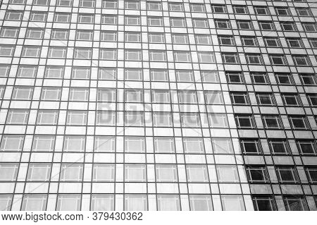 Geometry Glass Background. High-rise Housing. Modern Building Steel Walls And Glass Windows. Buildin