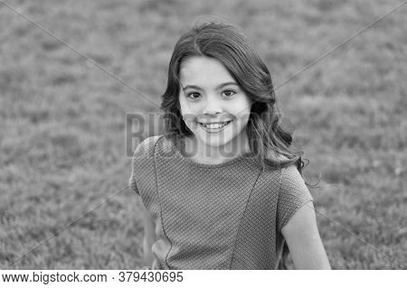 Smile Is Happiness. Happy Baby Smile On Green Grass. Little Girl With Cute Smile Summer Outdoor. Den