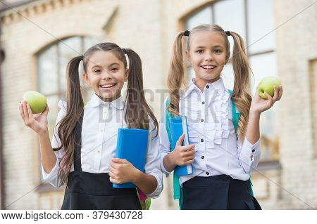 Students Girls Classmates With Backpacks Having School Lunch, Vitamin Nutrition Concept.