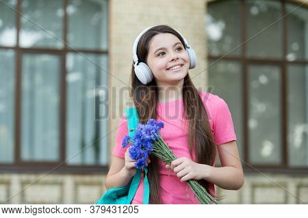 Teen Girl School Student With Stereo Headphones New Technology, Good Mood Concept.